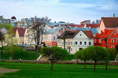"A neighborhood in Minsk, Belarus. Minsk is the capital and largest city of Belarus, situated on the Svislach and Nyamiha rivers. Photographer's Note: ""Some beautiful wee houses across the river in Minsk, Belarus. The Belarussians sure like to make their houses stand out. I like it!"""