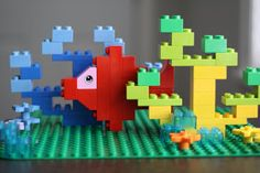 Story Time; DIY a Duplo Fish in a Coral Reef. As Project to use for your Under The Sea Theme. Designer Marie Artanag, shows you in Clear View Pictures, how you can build this scene! She is amazing with Duplo! Building amazing things.....Build with Me Blog!
