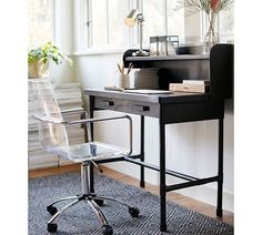 This clear desk chair is perfect for a small office space or desk. Since its see-through it helps give the impression of more space. AND I really love those arms gives it a unique touch. Check out our look for less on the blog today!  #office #officespace #officemakeover #modern #desk #deskspace #CopyCatChic