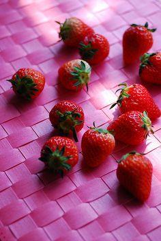 Sweet strawberries on pink