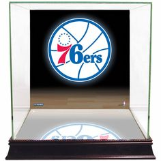 Philadelphia 76ers Logo Background Case - This customized graphic display case is a incredibly unique way to display your prized basketball. Our glass display cases are a necessity for any committed sports memorabilia enthusiast. Your timeless pieces whether autographed helmets or balls will be safe from dust and fading with our top-of-the-line exquisitely crafted cases. Each UV-protected display case is hand-made and includes a removable glass top for easy access. With a mirrored bottom and…