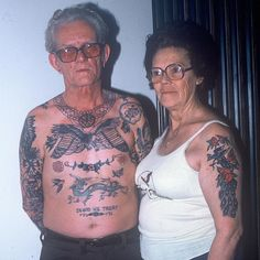 Audrey and Doc Ford from Texas. I believe the peacock on her arm was done by Bob Shaw. Photo taken by Bob Collins. #tattoohistory #bobshaw #lostlove2 #yellowbeakpress