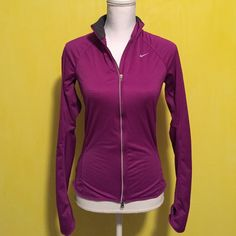 Nike dri fit waterproof jacket Nike waterproof jacket, like new with no flaws, dri fit, inside is cottony soft and warm, outside is waterproof, has thumb holes, has a back pocket, reflective detailing, perfect for runners, in excellent condition and looks a lot better on! Bundle to save ❤️ size womens small and fits slim Nike Jackets & Coats