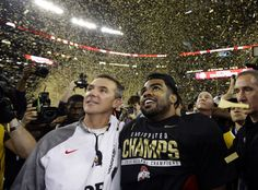 Ohio State head coach Urban Meyer and Cardale Jones celebrate after the NCAA college football playoff championship game against Oregon Monday, Jan. 12, 2015, in Arlington, Texas. Ohio State won 42-20. (AP Photo/David J. Phillip)