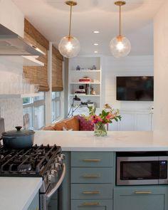 deep mint cabinets in open kitchen + globe pendants | via Small & Fabulous ~ Cityhaüs Design
