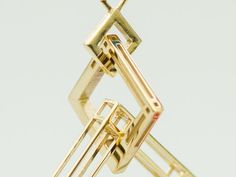 Interlocking Metal Earring in Polished Brass | one of Shapeways' pilot 3d printing programs