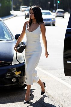 Selena Gomez's white midi is the perfect spring dress.