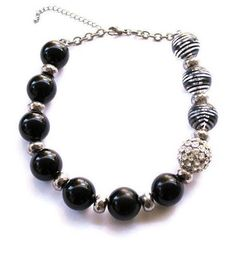 Vintage Chunky Bead Necklace In Black and Silver Statement Necklace 1980s Necklace. Black, Silver, Clear with Black, and a Silver Rhinestone Bead. This necklace is a real show stopper. Some wear to stripes on clear and strip beads. But hardly noticeable.  Necklace measures 21