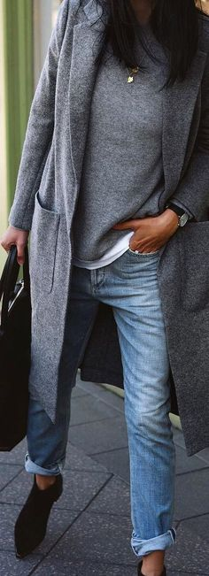 Casual everyday outfit with matching grey trench & sweater, white t-shirt peaking out add black booties & bag.