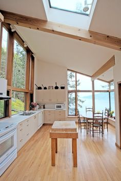 """""""I can't think of a house I'd rather do dishes in!"""" -- Houses Made of Wood and Light, Michele Dunkerley"""