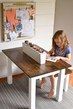 Make a stunning DIY Kid's Farmhouse Table with these step by step instructions. This kid's art table will foster independent learning and creative, open ended play for preschoolers and elementary school students. Give kids a place to color, play, and study with this DIY Farmhouse Table for Kids! - Our Handcrafted Life
