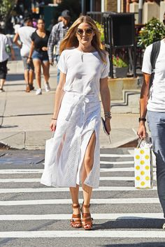 """glamour: """"All white, all summer. Photo: Getty Images """" MORE FASHION AND STREET STYLE"""