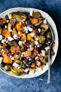 Sweet and spicy maple roasted butternut squash & brussels sprouts and savory, crispy bacon. This filling, veggie-packed dish is perfect for a side dish. Without bacon for vegetarian! Bacon Recipes, Lunch Recipes, Healthy Recipes, Delicious Recipes, Gluten Free Recipes, Warm Salad Recipes, Water Recipes, Healthy Appetizers, Grilling Recipes
