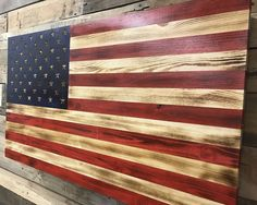 American Rustic Flag Slider The American Flag represents life, liberty, and the pursuit of happiness. This timeless image has been painstakingly re-created out of repurposed pallet wood to create a piece of art that you'd be proud to have on your wall. , the artwork is built on sliders to allow for quick and easy access. Included is high-density Kaizen foam that can be modified to store firearms, knives, flashlights, and your favorite accessories. Key locks are provided to ensure safety…
