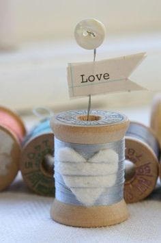 idea with wooden spool , possible to even use for a picture