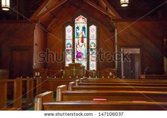Beautiful stained glass window in an old church - stock photo
