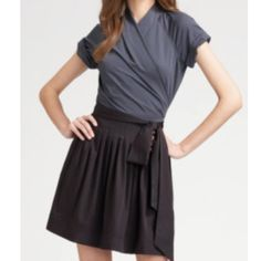 Diane vonFurstenberg Kaelen gray and black wrap This DVF is stunning. Sorry my pictures are dark more to come later. It features a beautiful shape wrap, pleated skirt, gray bodice and black skirt, and in perfect condition. Love this Diane von Furstenberg Dresses