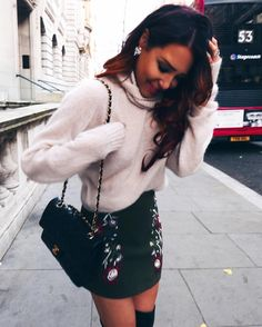 cozy sweater Chanel bag and mini skirt