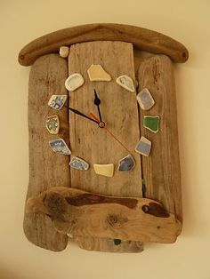 Handmade driftwood clock from North East England. Hour markers are from sea pottery from Seaton Carew and there is also a few pieces of Seaham seaglass