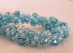 Seed Bead and Fire Polish Crystals Kumihimo Bracelet on Etsy, £18.00