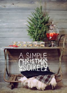 """""""A Simple #Christmas Soirée"""" : bar cart with mini tree, mulled wine cocktail decanter, and throw blankets in creamy neutrals and cozy plaid tartan.   Styling by Style Me Pretty; Photo by White Loft Studio"""