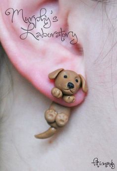 dog illusion earrings