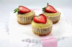 3 Lemon-Strawberry Cheesecake Cupcakes on a cake stand!