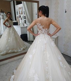 Pin for Later: 23 Wedding Dresses That Look Even More Gorgeous From the Back  A gown isn't complete without some lace.