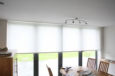 roller blinds over bi-folding doors Blinds For Bifold Doors, Blinds For Windows, Curtains With Blinds, Waterproof Blinds, Modern Window Coverings, White Roller Blinds, Zebra Blinds, Kitchen Blinds, House Blinds