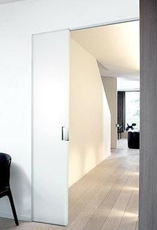 There are basically two types of barn door hardware. The first is a rustic, flat track sliding door system The second is a more modern roller and track style Wooden Sliding Doors, Sliding Door Systems, Sliding Door Hardware, Interior Minimalista, Pocket Doors, Internal Doors, Sweet Home, New Homes, Flooring