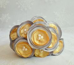 Buttercup Fabric Flowers Set of Twenty Four for making DIY Brides Bouquets and Wedding Bouquets. $50.00, via Etsy.