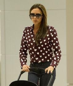 Victoria Beckham and daughter Harper arrive at JFK airport in NYC