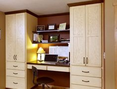 Cozy office space nestled between large red oak showplace cabinets
