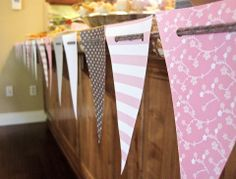 I used this tutorial as a guide for making the pennant banner. Only I made smaller triangles, and punched only 2 holes in each one. I really liked how I was able to assemble it there, and adjust the length based on the size of the bar.     How to: http://artsyfartsyshopaholic.blogspot.com/2011/04/tutorial-how-to-make-no-sew-paper-flag.html