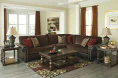 """The """"Arlette-Truffle"""" upholstery collection features a soft textured chenille fabric surrounding the seat and back cushions beautifully complemented by the rich brown faux leather polyurethane adorned with stylishly stitched details and nail head trim to perfectly capture the sophisticated beauty of classic traditional design."""
