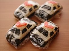 Shape rectangular rice balls and smash them a little in the front and back. Cut and add nori seaweed pieces for . Bento Recipes, Lunch Box Recipes, Baby Food Recipes, Gourmet Recipes, Bento Box Lunch For Kids, Bento Kids, Edible Food, Edible Art, Kids Menu
