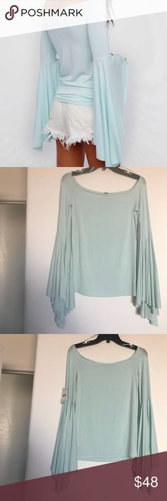 "Free People We The Free Birds of Paradise Top Sz S NWT Free People We The Free ""Birds of Paradise"" off the shoulder tee in the color seafoam/mint. Beautiful flare sleeves  Sz S See last photo for measurements. Free People Tops"