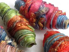 Love these beads!  They're made from, of all things, Tyvek!  by CarolynSaxbyTextiles