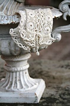 flower urn with white lace gloves