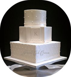 Elegant White Wedding Cake, like the different shapes.  Although I think I like it with the color bands.