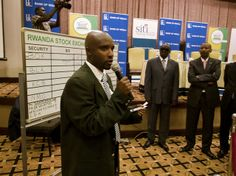RENEW: Bank of Kigali share trade on Rwanda Stock Exchange. Pierre Celestin Rwabukumba, Coordinator of the Rwanda Stock Exchange, talks to traders at the launch of the Bank of Kigali IPO at the Serena Hotel, Kigali, Rwanda. From kigaliwire.com  Photographer: Graham Holliday Some Rights Reserved