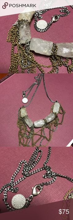 Natural Quartz Necklace This is a beautiful unique quartz necklace. There are silver and bronze tone chains dangling from the stones. Gemma Redux Jewelry Necklaces