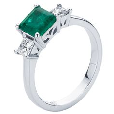 The \'Enchanted\' Emerald engagement ring with two side princess cut ...