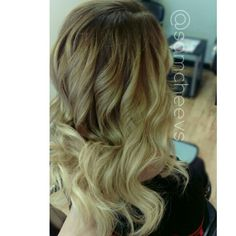 Brown color melt to blonde ends cut and styled hair design