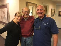 The face of a happy implant denture patient and the team who restored his smile to form and function.