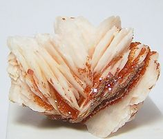 Red and Orange Vanadinite Crystals on White by FenderMinerals,