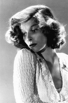 Note dress clips, v neck sweater with lace, hair unconventional soft curls, not waves. ALady Katherine Hepburn