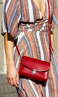 A cross-body is simply a must-have for every woman. The portable size easily transitions from day to night, and they can also be slung over an array of outfits. We LOVE this simple red leather cross body.