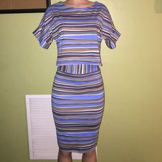 Striped Two Piece Set Get this striped brown, blue, cream and black two piece set. The crop top has full short sleeves and the matching skirt can be high waisted. The stretch is great on this set. The set was once in a boutique, so it's never been worn just tried on and put on to model. Other