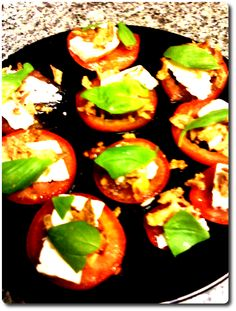 Tomato and basil tower with goat cheese and fried onions